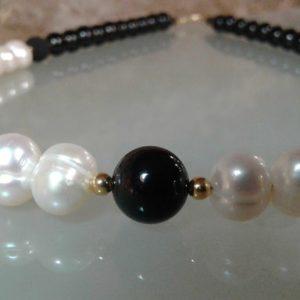 Collar lava perla obsidiana en secciones